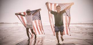 Happy children taking an american flag Royalty Free Stock Photography