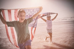 Happy children taking an american flag stock image