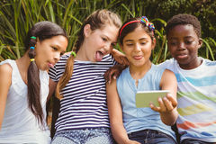 Happy children taking selfie at park Royalty Free Stock Photography