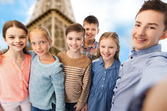 Happy children talking selfie over eiffel tower Royalty Free Stock Photo
