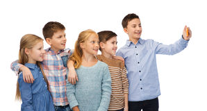 Happy children talking selfie by smartphone Royalty Free Stock Photos