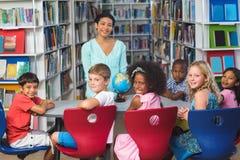 Happy children with teacher Stock Photo
