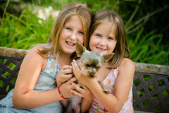 Happy children with their pet Stock Image
