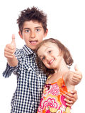 Happy children with thumbs up success Royalty Free Stock Photography
