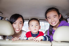 Happy children traveling in the car Stock Photo