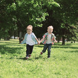 Happy children two boys brothers running together and having fun Stock Photo