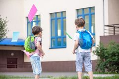 Happy children - two boys friends with books and backpacks on th royalty free stock photo