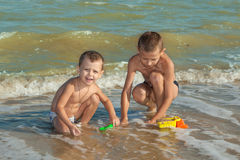 Happy  Children - two boys having fun on the beach Royalty Free Stock Photography