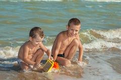 Happy  Children - two boys having fun on the beach Stock Image
