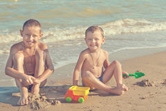 Happy  Children - two boys having fun on the beach Stock Photo