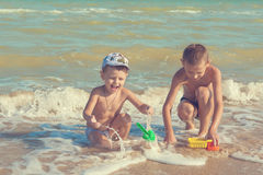 Happy  Children - two boys having fun on the beach Royalty Free Stock Photos