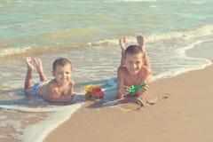 Happy  Children - two boys having fun on the beach Royalty Free Stock Photo