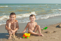 Happy  Children - two boys having fun on the beach Royalty Free Stock Images