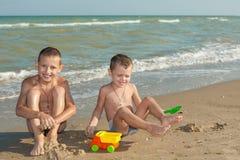 Happy  Children - two boys having fun on the beach Stock Photos