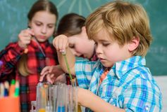Happy children use tubes. back to school. biology education. Microscope. Biology school laboratory equipment stock photo