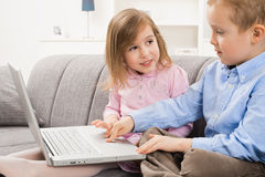 Happy children using laptop computer Royalty Free Stock Image