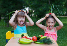 Happy children with vegetables Stock Photography