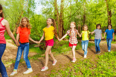 Happy children walking in the forest holding hands Stock Photo