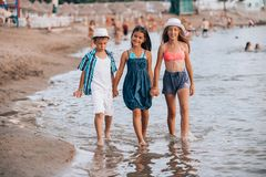 Happy children walking together through the water stock image