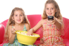 Happy children watch a movi. Shot of a happy children watching a movie eating popcorn Stock Images
