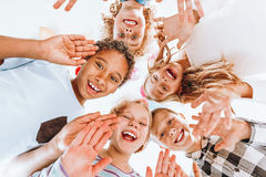 Happy children waving. Group of happy children waving at the camera royalty free stock photos