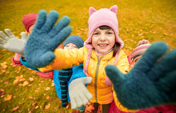 Happy children waving hands in autumn park Royalty Free Stock Photo