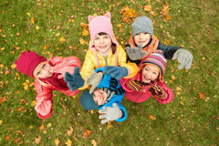 Happy children waving hands in autumn park Royalty Free Stock Photo