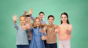 Happy children waving hands Stock Images