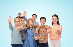 Happy children waving hands Stock Image