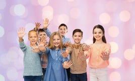 Happy children waving hands Royalty Free Stock Image