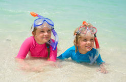 Happy children wearing snorkeling gear  on the beach Royalty Free Stock Photos