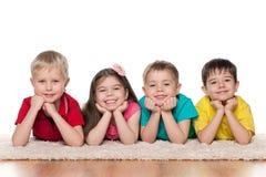 Happy children on the white carpet Stock Photos