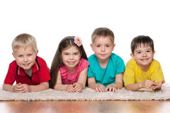 Happy children on the white carpet Royalty Free Stock Photos
