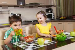 Happy children who eat healthy food Royalty Free Stock Photo