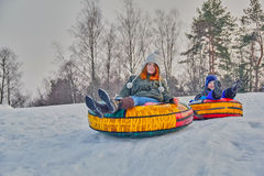 Happy children on a winter sleigh ride Royalty Free Stock Images