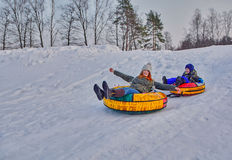 Happy children on a winter sleigh ride Stock Photography