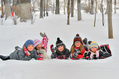 Happy children in winterwear laughing Royalty Free Stock Images