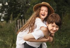Free Happy Children With Piggyback Riding In Sunset Light Stock Photography - 208368172