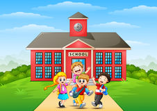 Happy childrens cartoon in front of school building Royalty Free Stock Image