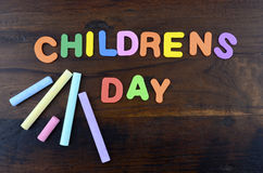 Happy Childrens Day concept with colorful play letters. Royalty Free Stock Photos