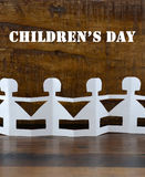 Happy Childrens Day concept with paper dolls Stock Images