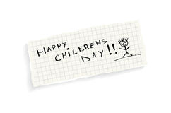 Happy childrens day!. Hand writing text on a piece of math paper isolated on a white background stock illustration
