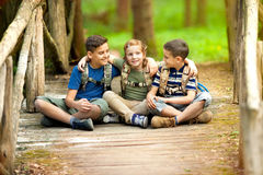 Happy childs in green forest playing,concept of kids vacations a Stock Photo