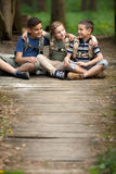 Happy childs in green forest playing,concept of kids vacations a Stock Photography