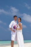 Happy chinese asian couple in maldives wedding shoot Royalty Free Stock Image