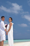 Happy chinese asian couple in maldives wedding shoot Stock Image