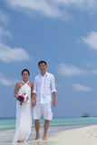 Happy chinese asian couple in maldives wedding shoot Royalty Free Stock Photos
