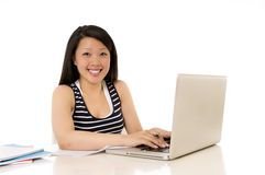 Happy chinese asian woman student working laptop Royalty Free Stock Images