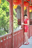 Happy Chinese bride in red cheongsam at traditional wedding day Stock Photos