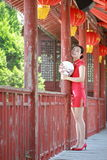 Happy Chinese bride in red cheongsam at traditional wedding day Royalty Free Stock Photography